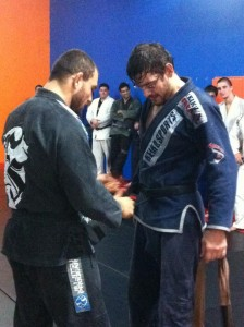 Marcio Oliveira receiving his black belt.